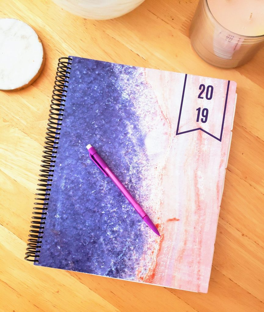 Piece of Cake Designs 2019 planner on a desk with a pencil on top