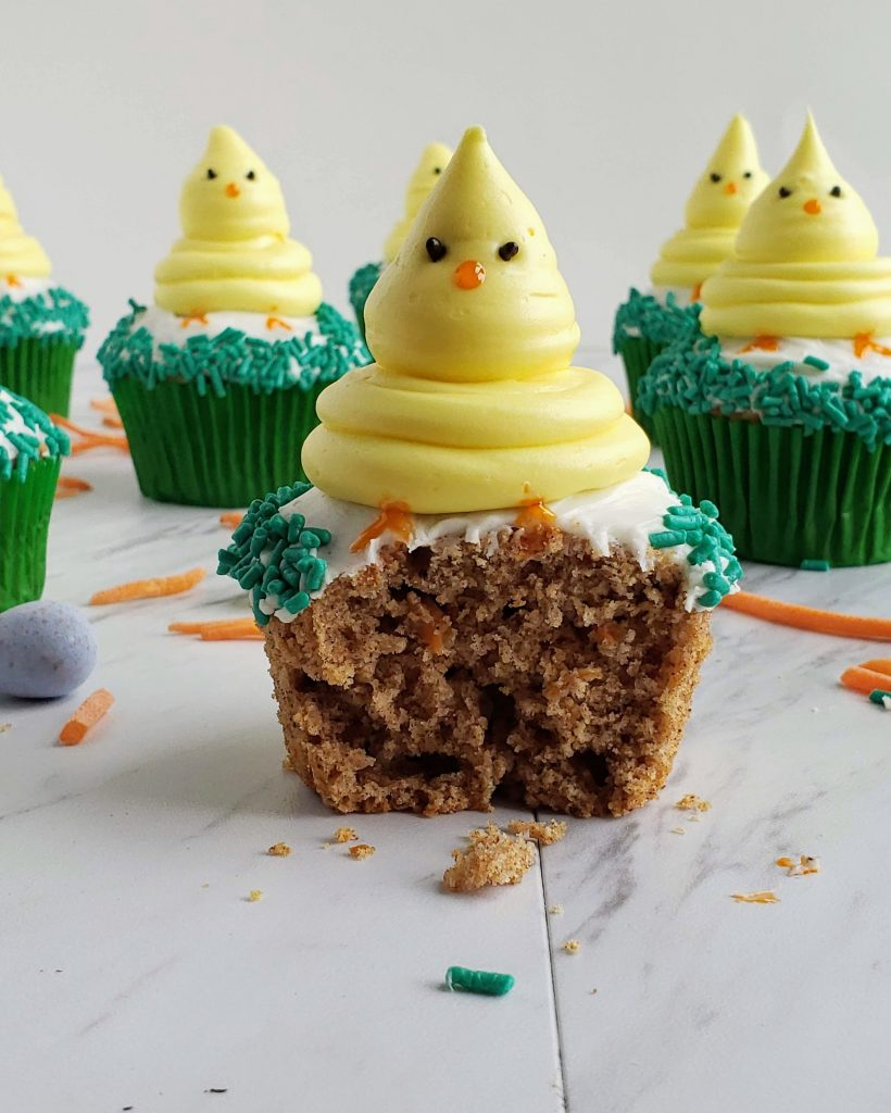 bite taken out of carrot cake cupcakes with Easter chick on top