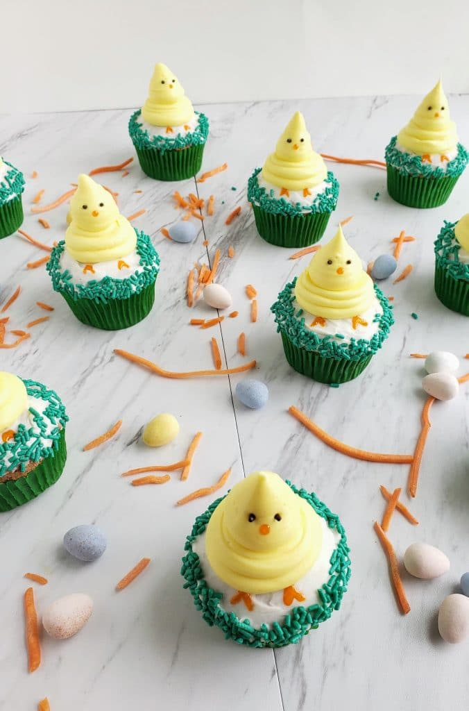 3/4 image of carrot cake cupcakes with Easter chicks on top