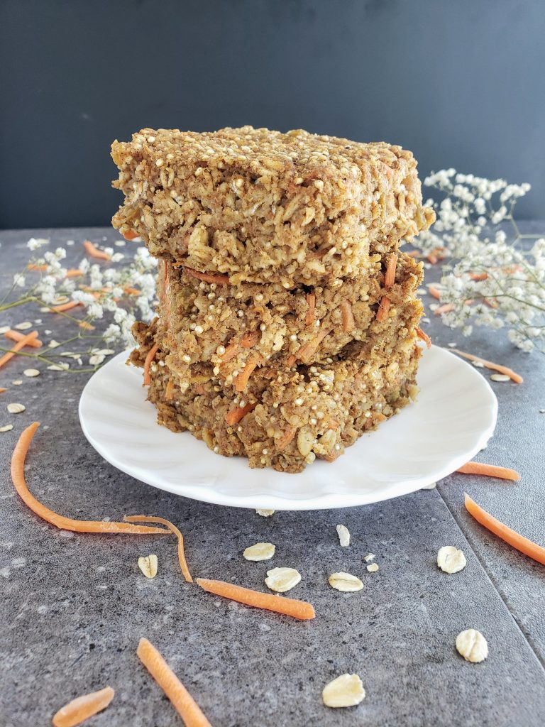 stack of carrot cake oatmeal bars on a white plate