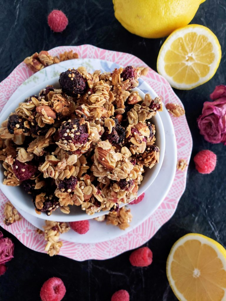 overhead shot of homemade granola in a bowl stacked on two plates