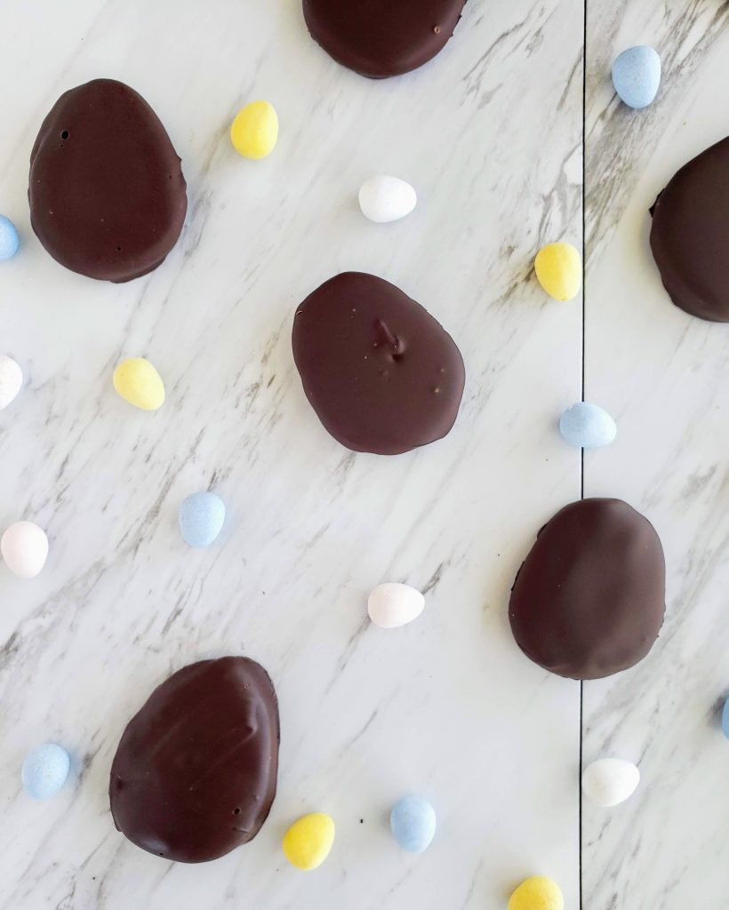 Homemade peanut butter eggs on a marble background