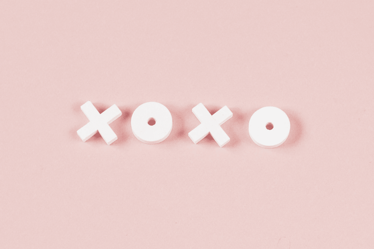 xoxo letters on a light pink background