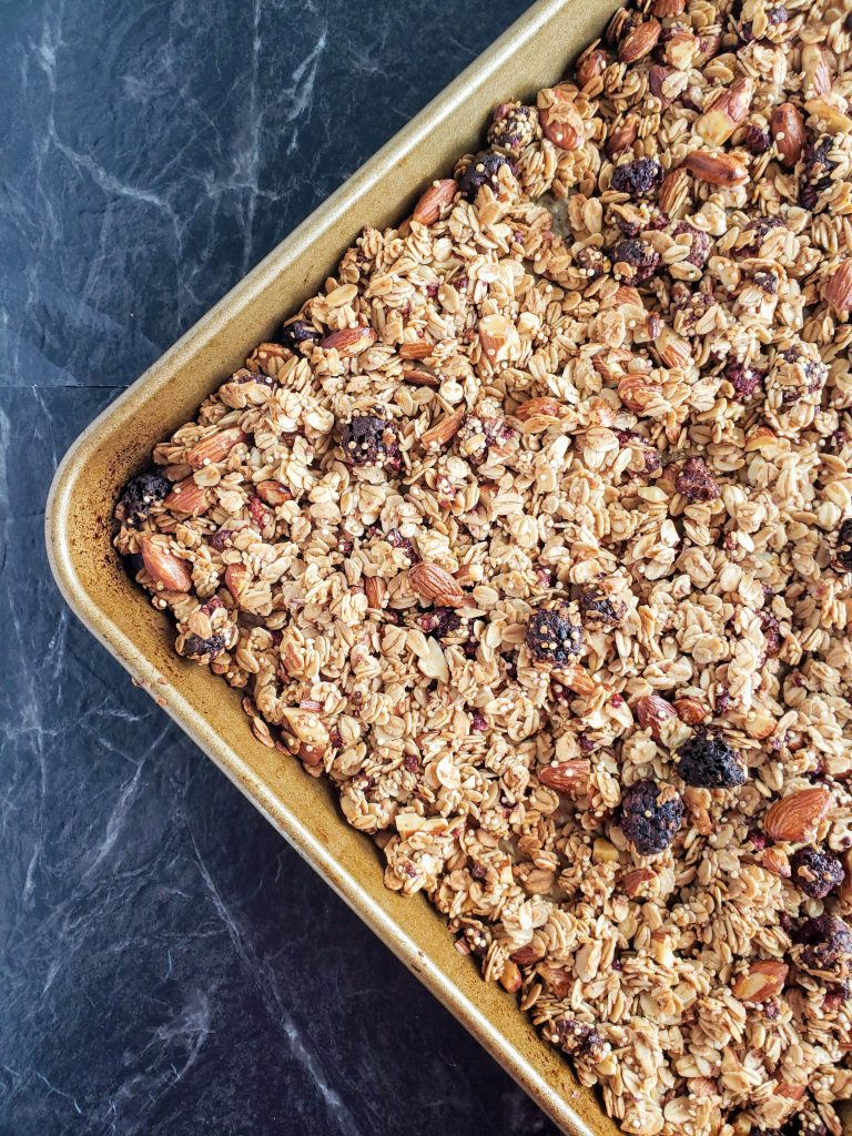 baked homemade granola on a gold pan