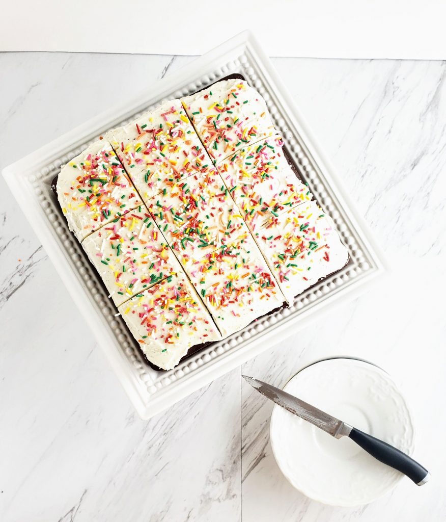 cake with sprinkles sliced. knife sitting on plate