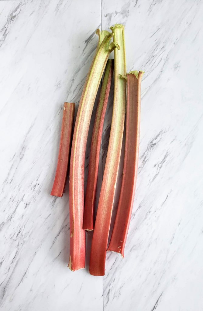 rhubarb stalks on a white marble countertop