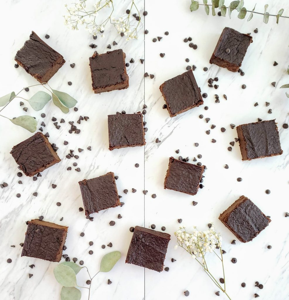 sweet potato brownie squares surrounded by mini chocolate chips and greenery