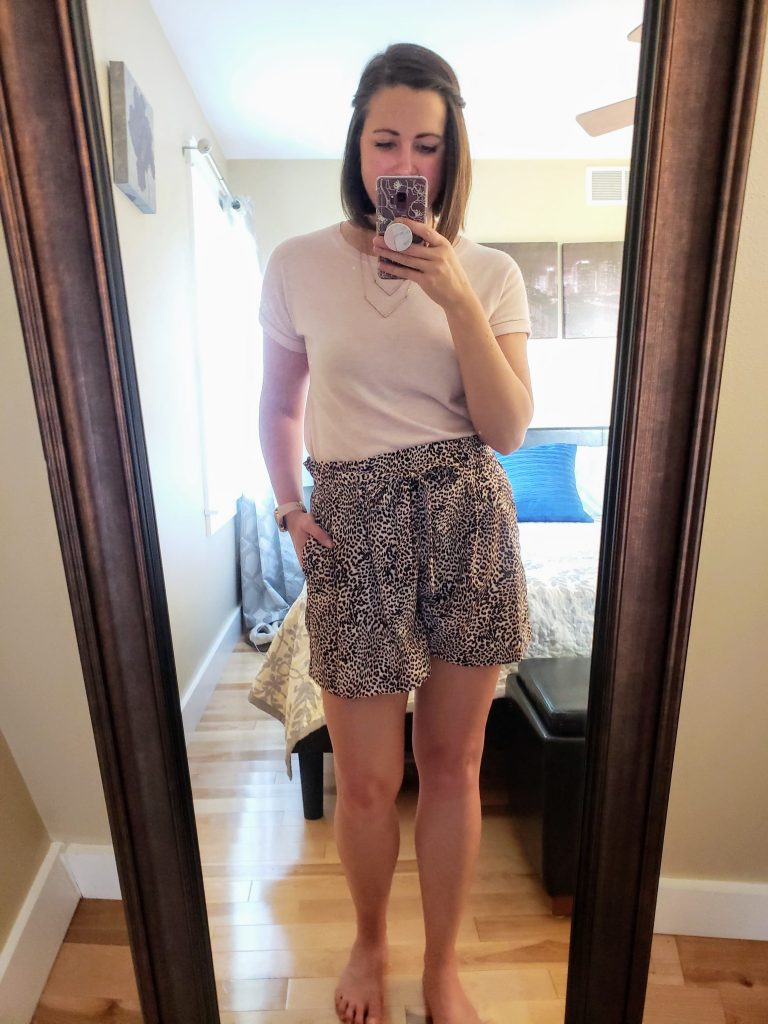 standing in front of mirror: paperbag leopard print shorts