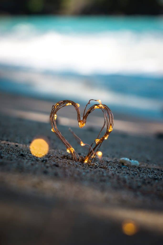 wooden heart in the sand
