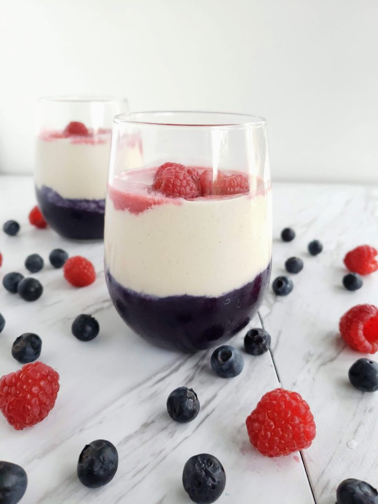 two glasses of layered tropical berry smoothie