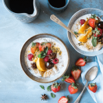 bowls of oatmeal with fresh fruit on top