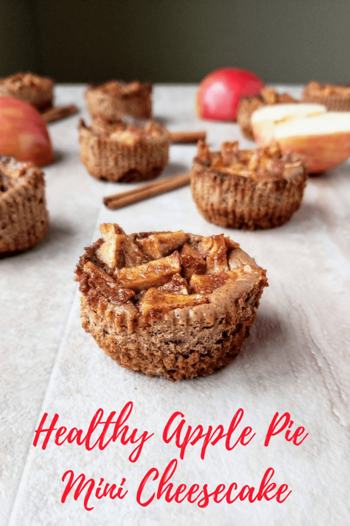These mini apple pie cheesecakes are healthy and made in muffin tins. They have a cinnamon graham cracker crust, and are the perfect fall dessert, or Thanksgiving dessert. #thanksgiving #healthycheesecake #minidesserts #holidaydesserts #easycheesecakerecipe