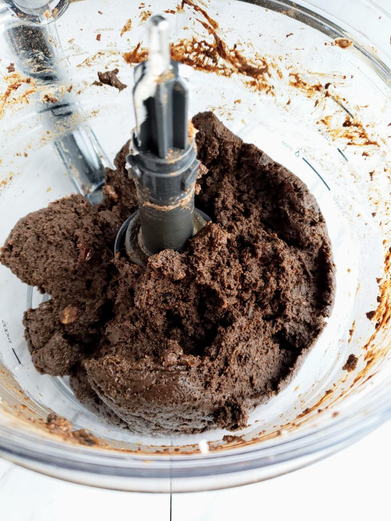 Blended truffle ingredients in a food processor