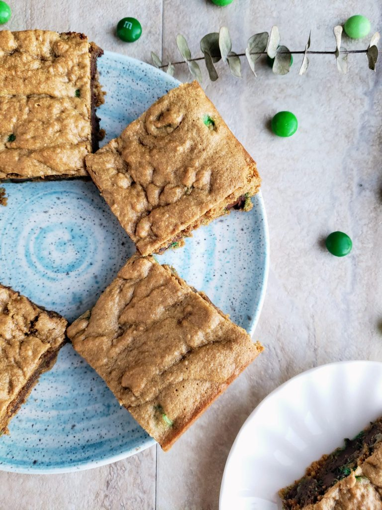 four healthy blondie bars on a blue plate
