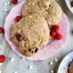 two raspberry white chocolate scones on a pink plate