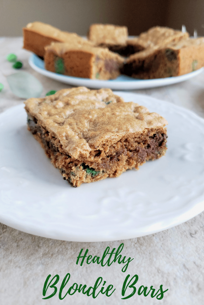 These healthy blondie bars are the perfect St. Patrick's day dessert recipe. With mint M&M's, these bars are chewy, gooey and the perfect homemade healthy cookie bar. Make these healthier by using dark chocolate chips. #stpatricksdaydesserts #healthybarrecipes #blondies #blondiebars #healthydessertideas