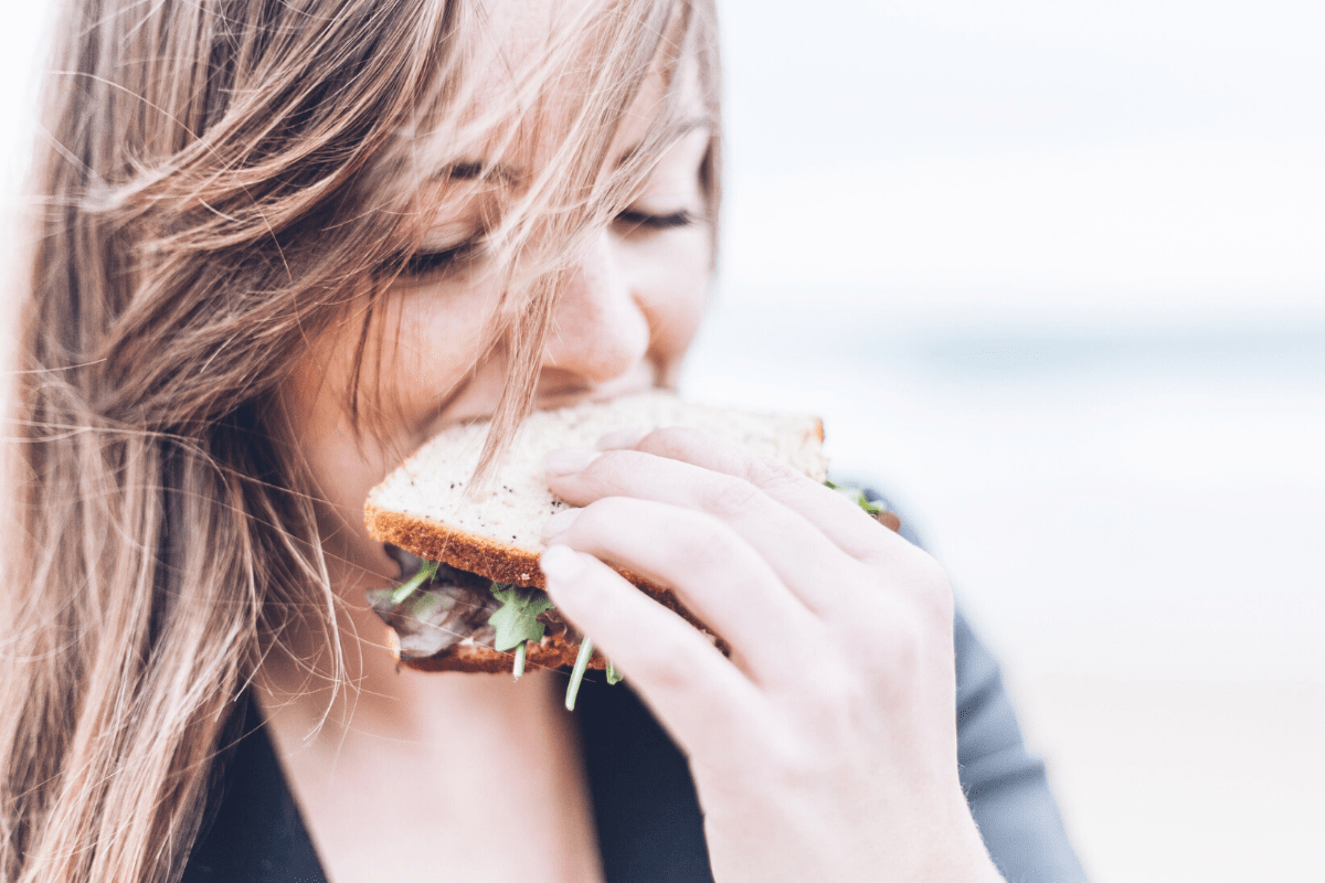 woman eating a sandwich