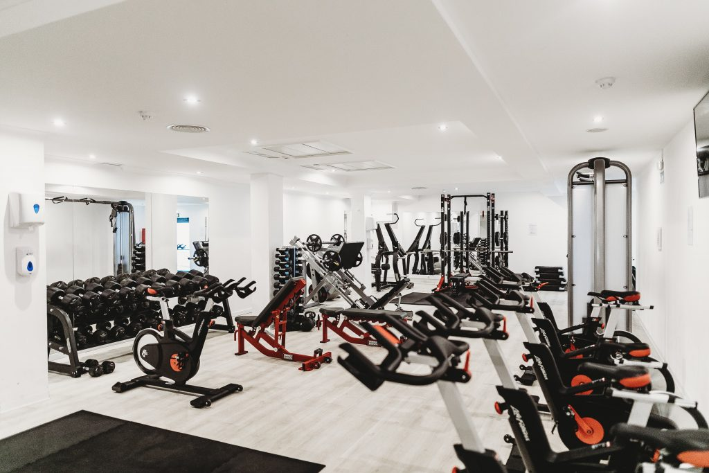 black spin exercise bikes and equipment in a gym