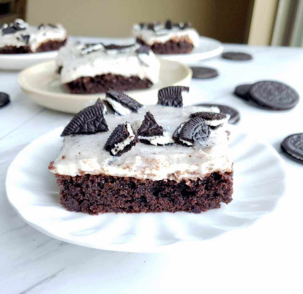 Single slice of Oreo pudding brownie with other brownies behind it