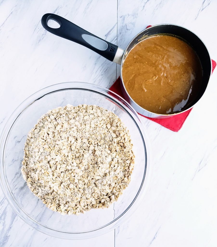 large bowl of grains next to a pan with peanut butter filling