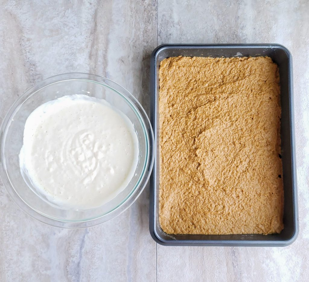 pan of pumpkin bar batter next to cheesecake batter