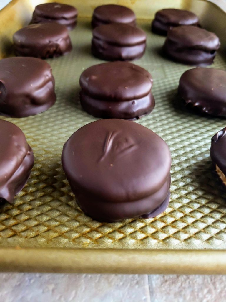 cookie sheet lined with chocolate covered peanut butter Ritz cookies