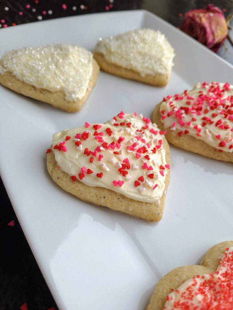 frosted and sprinkled heart cutout gluten free sugar cookies