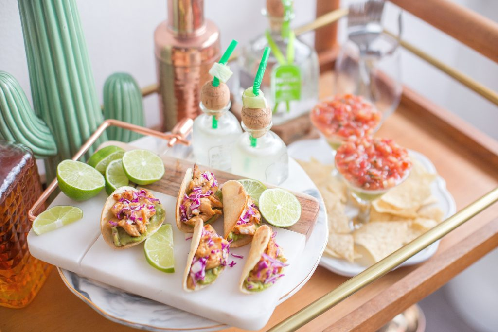 bar cart with a mini cactus, drink station, mini tacos and chips and salsa